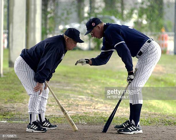 Under cover from the rain New York Yankees coach Don Zimmer and player development coach Frank Howard discuss the mechanics of baseball 22 February...