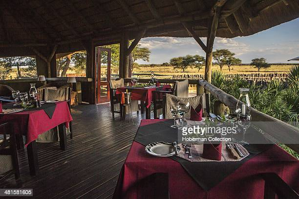 Under Cover Thatched Area Of Dining Room With Tables And Chairs With Beautiful Nature Views At Frans Indingo Lodge In Namibia