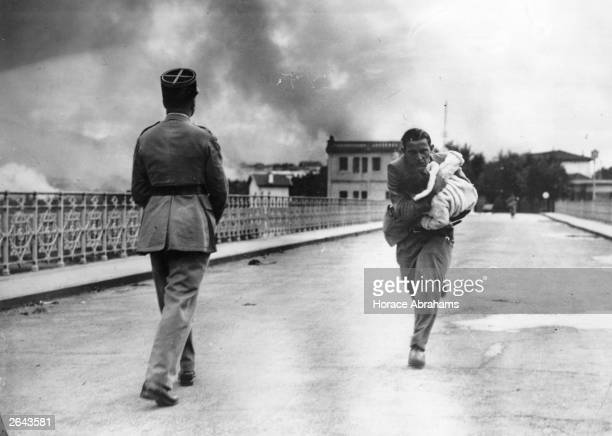 Under fire French journalist Raymond Vankers dashes across the International bridge over the the Bidasoa river from Irún Spain to Hendaye France to...