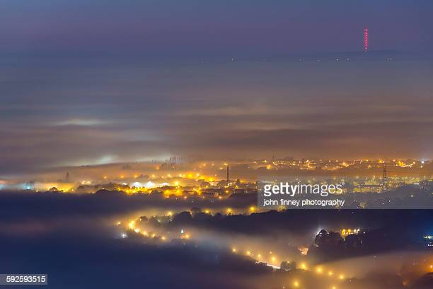 uk under fog, greater manchchester, winter hill - manchester uk stock photos and pictures