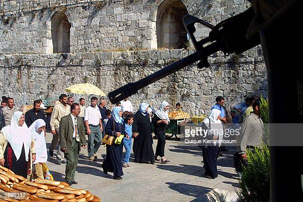 Under heavy security Muslim worshippers make their way through the Lions Gate to the Temple Mount known in Arabic as El Harem El Sharif site of Al...