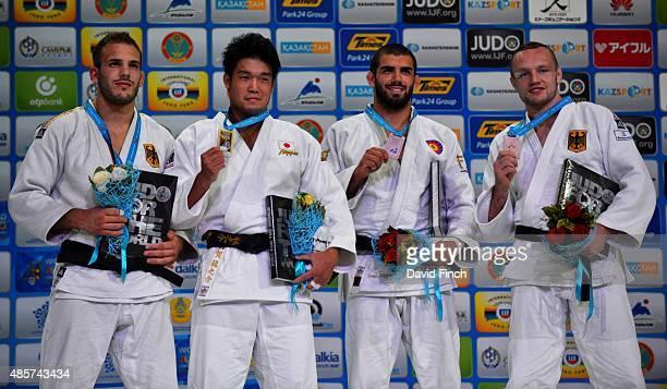 Under kg medallists LR Silver KarlRichard Frey GER Gold Ryunosuke Haga JPN Bronzes Toma Nikiforov BEL and Dimitri Peters GER during the 2015 Astana...