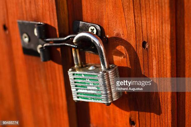 under lock and key - padlock stock photos and pictures