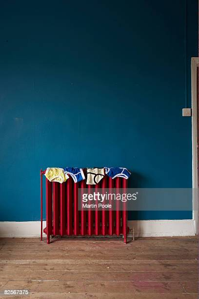 under pants on radiator - drying stock pictures, royalty-free photos & images
