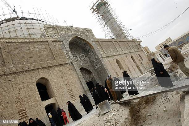 Under repair pilgrims visit the alAskareyya Shrine which embraces the tombs of the 10th and 11th Imams Ali AlHadi and his son Hassan AlAskari in the...
