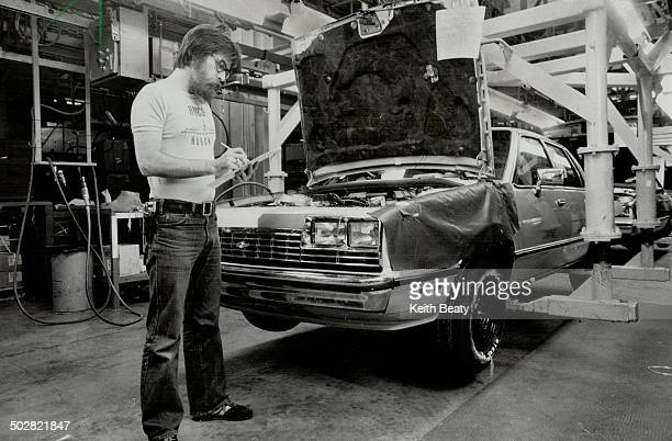 Under scrutiny Tom McVey inspects car on General Motors' assembly line in Oshawa The fact that such inspectors are necessary to ensure quality says a...