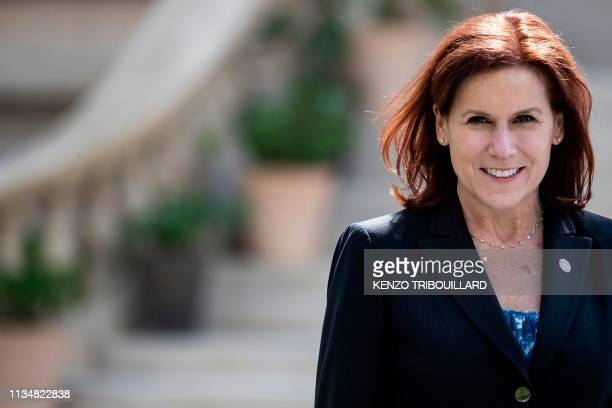 US Under Secretary of Homeland Security Claire Grady poses for a group photo at the French Ministry of Interior in Paris on April 4 during an...
