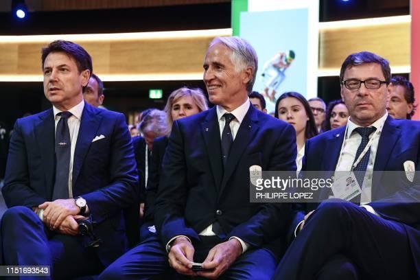 Under secretary of State Giancarlo Giorgetti , Italian National Olympic Commitee president Giovanni Malago and Italian Prime Minister Giuseppe Conte...