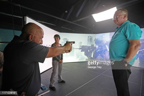 Under Sheriff Shaun Bufton , critiques Utah teachers Coni Brooks , and Tom Erekson after they interacted with a video simulator that creates an...