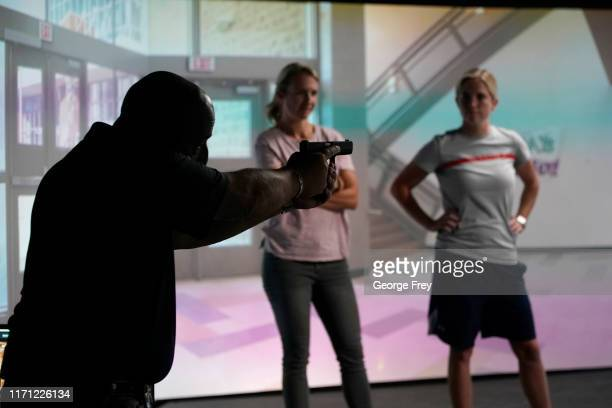 Under Sheriff Shaun Bufton , critiques Utah teachers Holli Averett , and Natalie Bailey after they interacted with a video simulator that creates an...