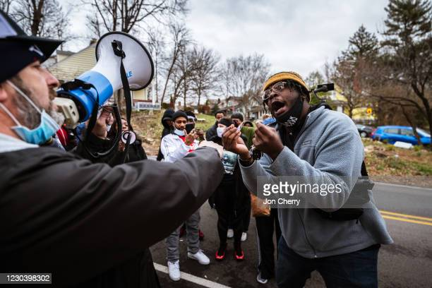 Under Siege protester and a Black Lives Matter activist argue in front Sen. Majority Leader Mitch McConnell's vandalized home on January 2, 2021 in...