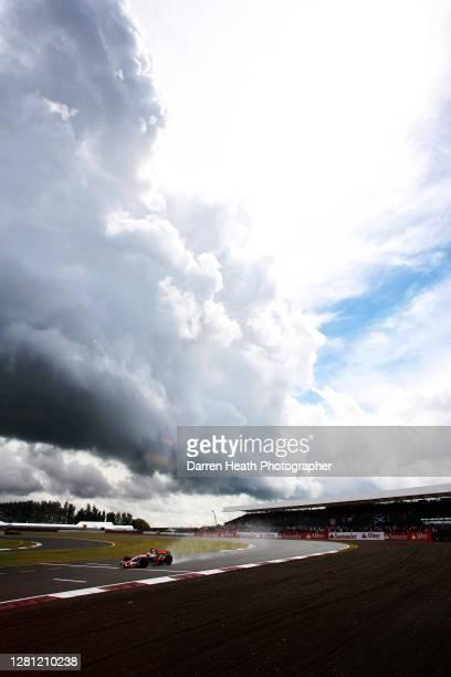 Under storm clouds British McLaren Formula One driver Lewis Hamilton drives his McLaren MP4-23 car during the 2008 British Grand Prix at Silverstone...