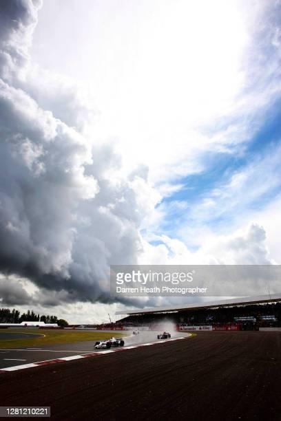 Under storm clouds German BMW Sauber Formula One driver Nick Heidfeld drives his BMW Sauber F1.08 car during the 2008 British Grand Prix at...