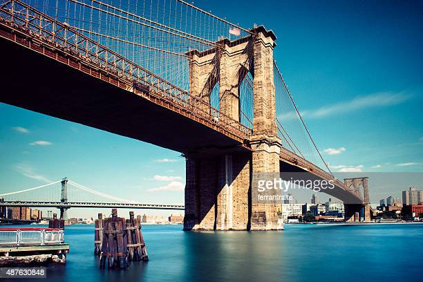 under the brooklyn bridge in new york city - brooklyn bridge stock pictures, royalty-free photos & images