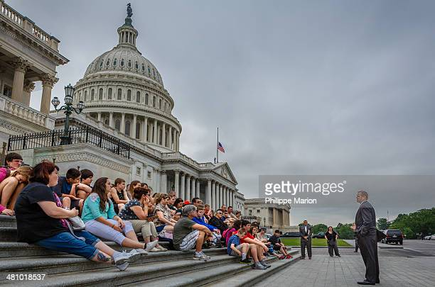 Under the dome of the United States Capitol Building, a Congressman addresses visiting constituents on the steps of the United States House of...
