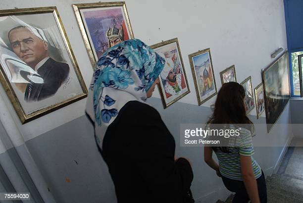 22 Under the gaze of Turkey's secular founder Mustafa Kemal Ataturk Turkish women descend the stairs at a state school to vote in parliamentary...