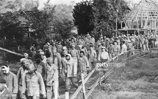 Under the guard of Communist Viet Minh troops, French and Vietnamese prisoners of war march from the battlefields of Dien Bien Phu. The 1954 battle...