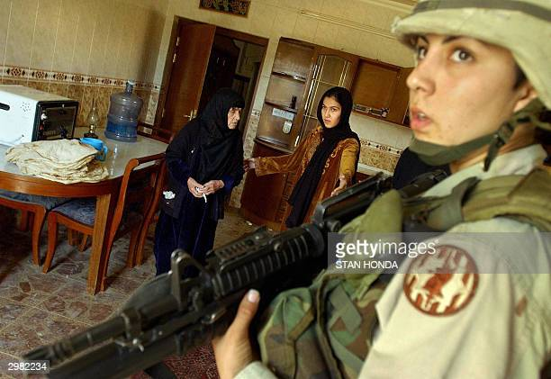 Under the guard of US Army Sgt. Angelica Lopez of the 401 MP Company, 720 MP Battalion, based at the 4th Infantry Division headquarters in Tikrit, an...