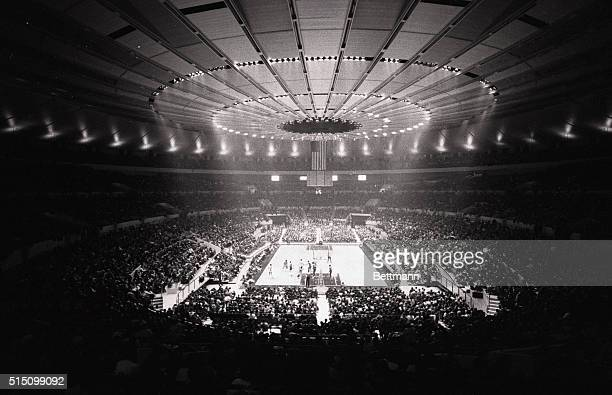 Under the magnificence of the welllit roof of the new Madison Square Garden college basketball made its debut Playing the game in front of 5214 fans...
