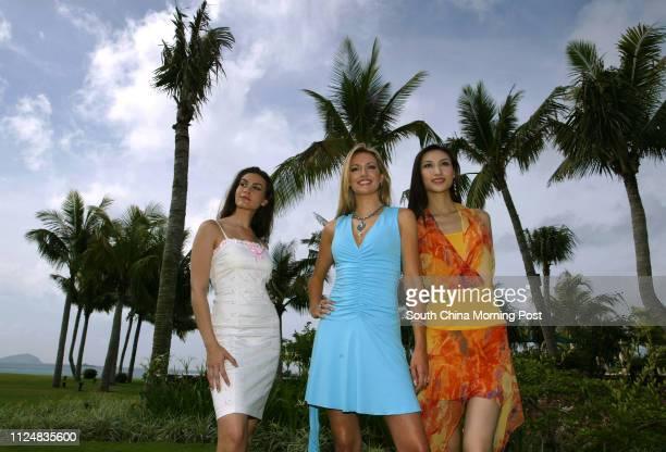 Under the palms of Yalong Bay in Sanya Hainan are lastyear's runnerup Miss Canada Nazanin AfshinJam Miss World Rosanna Davison of Ireland and Miss...