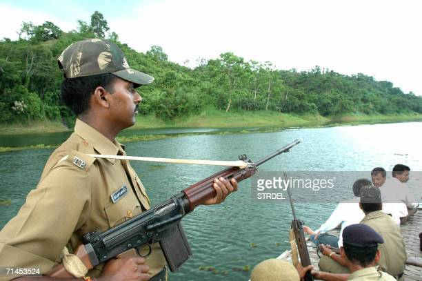 Under the shadow of police guns tourists go on a boat trip on Dambur Lake about 145 kms south of Agartala capital of Indias northeastern state of...