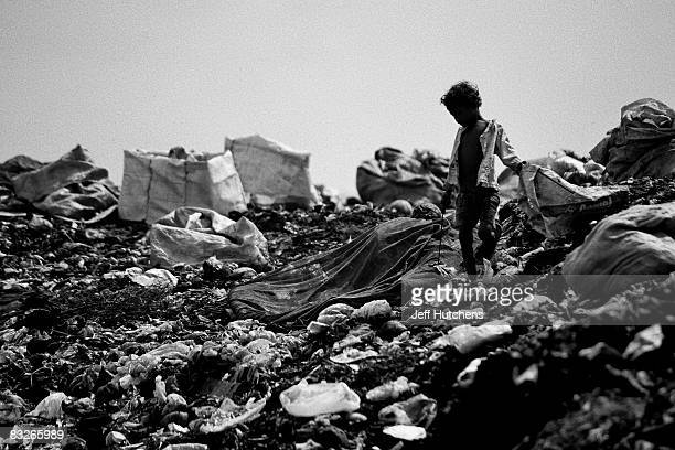 Under the shadow of the Khmer Rouge Tribunal children and their families sift through a garbage dump to make a living March 28 2007 in Phnom Penh...