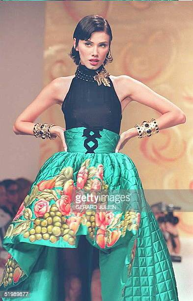 Under the spell of Dionysus father of celebration and elation Carven's Maguy Muzy paints a still life of grapes and roses on a huge corolla skirt of...