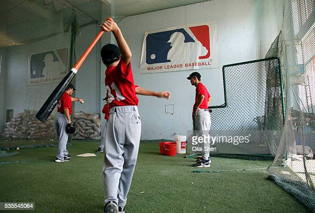 Under the supervision of assistant coach Charlie Iacono players take up batting practice at a summer training camp run by Major League Baseball Wuxi...