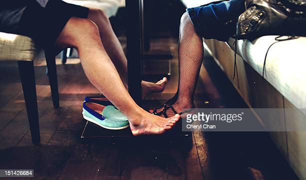 under the table - stockings no shoes stock pictures, royalty-free photos & images