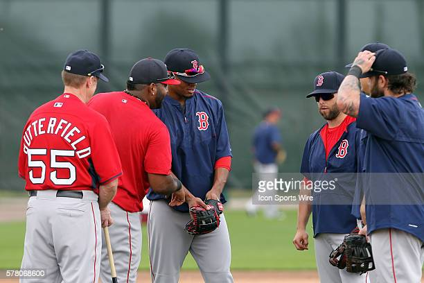Under the watchful eye of coach Brian Butterfield Pablos Sandoval in red pullover jokes around with Xavier Bogaerts and Dustin Pedroia as Mike Napoli...