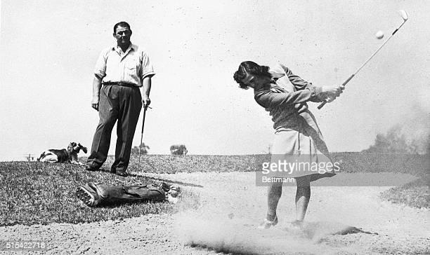 Under the watchful eye of wrestlergolferhusband George Zaharias Mrs Mildred Babe Didrikson Zaharias gets in a little golfing practice for the...
