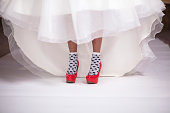 red shoes under white wedding dress