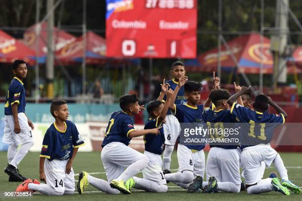 Under13 Ecuadorian players celebrate after scoring during a friendly match with Colombia in Medellin on January 18 2018 / AFP PHOTO / JOAQUIN...