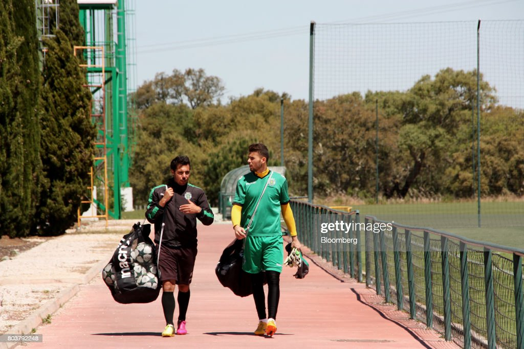 Under-18s soccer players carry training equipment after completing a session at the Sporting Clube de Portugal (SCP) sporting academy in Lisbon, Portugal, on Friday, April 28, 2017. Portuguese teams breed athletes for the most lucrative leagues in the worlds richest sport and it gives the nation of 10 million with limited domestic income from television rights and merchandising a slice of global soccers riches. Photographer: Henrique Almeida/Bloomberg via Getty Images