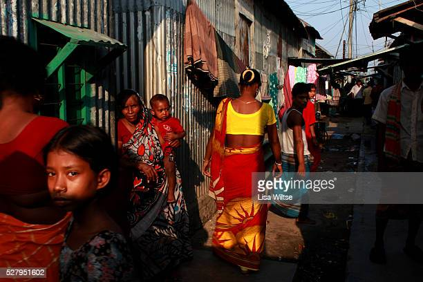 Underage sex workers waiting in the alleyways for customers in the central alleyway of Daulatdia Bangladesh on the banks of the Padma River It is the...