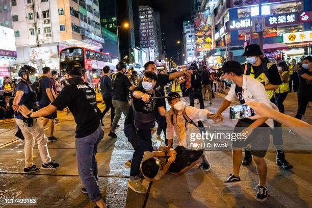 Undercover police arrested attendees during a memorial vigil in Mongkok on June 4 2020 in Hong Kong China Thousands gathered for the annual memorial...