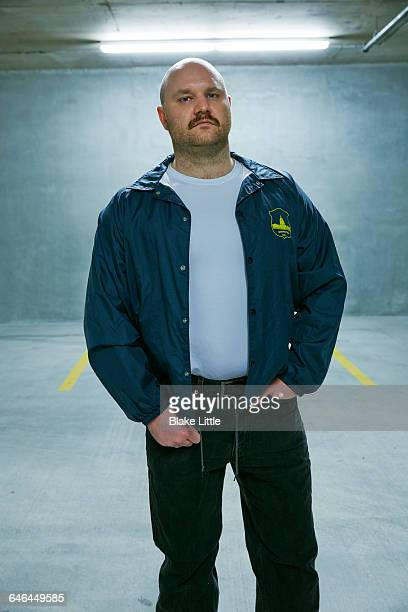 Undercover Policeman Standing in Garage