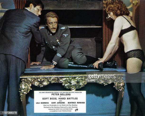 Undercovers Hero lobbycard from left Rex Stallings Peter Sellers Gabriella Licudi 1974