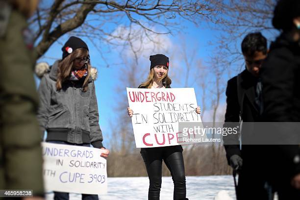 Undergrad Emily Irwin stands in solidarity with the T.A.s. York University striking Teaching Assistants and Graduate Assistants at York were joined...
