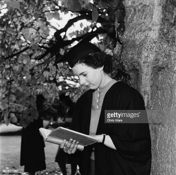 Undergraduate student M. Bryant reading in the grounds of Girton College, Cambridge, October 1948. The women's college was given full college status...