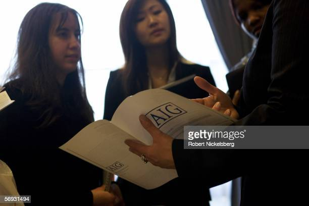 Undergraduate students at Rutgers University speak with a representative from AIG a financial services and insurance company during a job fair at...