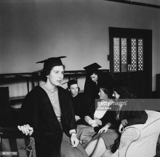 Undergraduate students in the common room at Girton College, Cambridge, October 1948. They are M. Bryant, A.V. Brehme, S. Brenner, M.O. Lewin and H....
