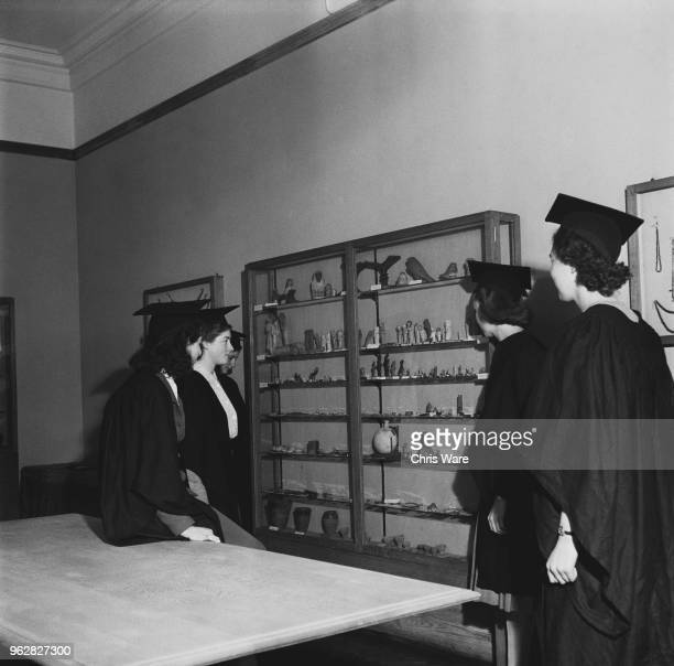 Undergraduate students viewing a display of ancient Egyptian artefacts in a room at Girton College, Cambridge, October 1948. The women's college was...