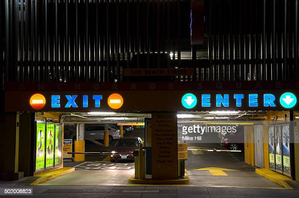 underground car park entrance at night - entrance sign stock photos and pictures