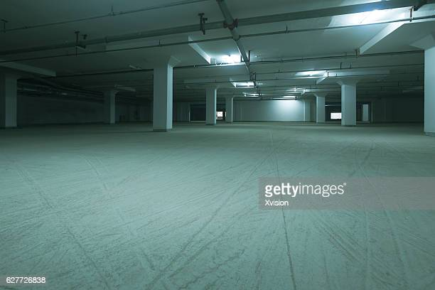 Underground car parking lot with lights on