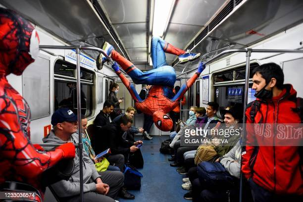 Underground dancers dressed in Spiderman costumes perform in the subway of Saint Petersburg late on May 21, 2021.