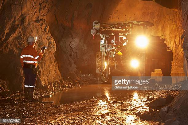 underground drill rig front view with miner - underground mining stock photos and pictures
