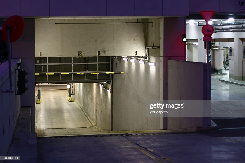 underground garage entrance with lights inside at night : Stock Photo