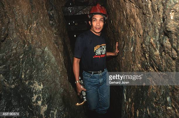 Underground in a gold mine. The Diwalwal gold mining community is built on stilts along the hill slopes, without any water or sanitation. Over...
