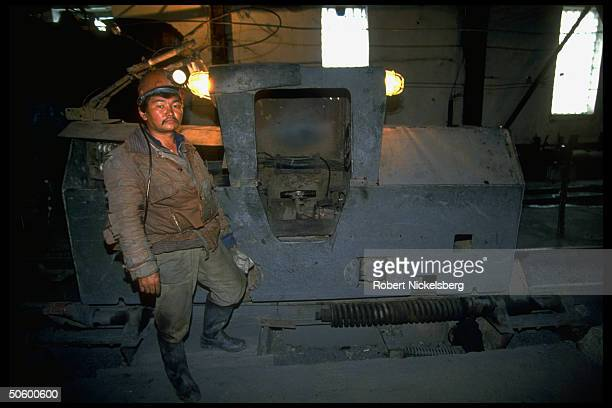 Underground miner at Bakyrchik gold mine, 1 of world's largest gold deposits producing 200,000 tons of ore per yr. Yielding 6 to 19 grams of gold per...